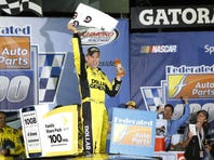 Sprint Cup Series driver Matt Kenseth (20) celebrates in Victory Lane after winning the Federated Auto Parts 400 at Richmond International Raceway.