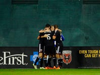 Oct 28, 2015; Washington, DC, USA; D.C. United forward Chris Rolfe (18) celebrates with teammates after scoring a goal against the New England Revolution during the second half at Robert F. Kennedy Memorial. D.C. United won 2-1. Mandatory Credit: Brad Mills-USA TODAY Sports