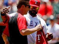 Texas Rangers designated hitter Prince Fielder (84) is presented with his All Star jersey