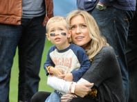 Kristin Cavallari holds son Camden prior to the start of the NFL game between the Chicago Bears and the Oakland Raiders at Soldier Field on October 4, 2015 in Chicago, Illinois. The Chicago Bears defeated the Oakland Raiders 22-20.