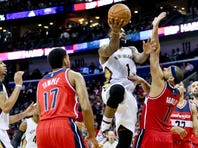 Dec 11, 2015; New Orleans, LA, USA; New Orleans Pelicans guard Tyreke Evans (1) shoots over Washington Wizards guard Jared Dudley (1) during the second half of a game at the Smoothie King Center. The Pelicans defeated the Wizards 107-105. Mandatory Credit: Derick E. Hingle-USA TODAY Sports