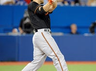 Sep 4, 2015; Toronto, Ontario, CAN; Baltimore Orioles Chris Davis (19) hits a two run home run against the Toronto Blue jays in the sixth inning at Rogers Centre. Mandatory Credit: Peter Llewellyn-USA TODAY Sports