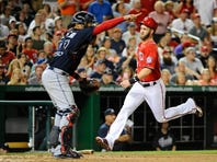 Sep 5, 2015; Washington, DC, USA; Washington Nationals center fielder Bryce Harper (34) scores a run as Atlanta Braves catcher Christian Bethancourt (27) looks on during the fifth inning at Nationals Park. Mandatory Credit: Brad Mills-USA TODAY Sports