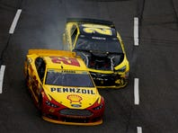 Matt Kenseth, driver of the #20 Dollar General Toyota, makes contact with Joey Logano, driver of the #22 Shell Pennzoil Ford, during the NASCAR Sprint Cup Series Goody's Headache Relief Shot 500 at Martinsville Speedway on November 1, 2015 in Martinsville, Virginia