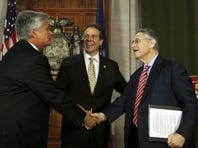 Former Senate Majority Leader Dean Skelos, R-Rockville Centre, left, New York Gov. Andrew Cuomo, center, and former Assembly Speaker Sheldon Silver, D-Manhattan, leave a June 2014 news conference in Albany.