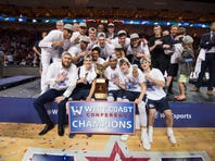 March 8, 2016; Las Vegas, NV, USA; Gonzaga Bulldogs players celebrate with the championship trophy against the Saint Mary's Gaels after the game in the finals of the West Coast Conference tournament at Orleans Arena. Mandatory Credit: Kyle Terada-USA TODAY Sports