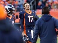Dec 13, 2015; Denver, CO, USA; Denver Broncos quarterback Brock Osweiler (17) walks off the field after being sacked during the second half against the Oakland Raiders  at Sports Authority Field at Mile High. The Raiders won 15-12. Mandatory Credit: Chris Humphreys-USA TODAY Sports