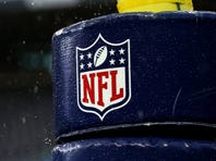 Detail image of the NFL logo on a goal post before the 2015 NFC Championship game between the Seattle Seahawks and the Green Bay Packers at CenturyLink Field on January 18, 2015 in Seattle
