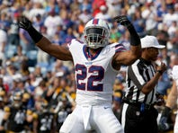 Aug 29, 2015; Orchard Park, NY, USA; Buffalo Bills running back Fred Jackson (22) celebrates his run during the first quarter against the Pittsburgh Steelers at Ralph Wilson Stadium. Mandatory Credit: Timothy T. Ludwig-USA TODAY Sports