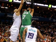 Dec 23, 2015; Charlotte, NC, USA; Boston Celtics forward center Jared Sullinger (7) drives to the basket and scores as he is defended by Charlotte Hornets guard Nick Batum and forward P.J. Hairston (19) during the second half of the game at Time Warner Cable Arena.  Celtics win 102-89. Mandatory Credit: Sam Sharpe-USA TODAY Sports