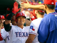 Sep 29, 2015; Arlington, TX, USA; Texas Rangers right fielder Shin-Soo Choo (middle) celebrates with teammates after hitting a two-run home run during the first inning against the Detroit Tigers at Globe Life Park in Arlington. Mandatory Credit: Kevin Jairaj-USA TODAY Sports