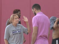 Basketball Hall of Famer Nancy Lieberman high-fives Kings forward Peja Stojakovic at Summer League in Las Vegas.
