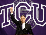 """FORT WORTH, TX - OCTOBER 10:  Texas Christian University Athletic Director Chris Del Conte flashes the 'Horned  Frogs"""" during a press conference in which TCU accepted an invention to join the Big XII conference on October 10, 2011 in Fort Worth, Texas. (Photo by Brandon Wade/Getty Images)"""