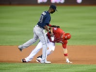 WASHINGTON, DC - SEPTEMBER 05:  Pedro Ciriaco #13 of the Atlanta Braves tags out Ryan Zimmerman #11 of the Washington Nationals trying to stretch out a single to double in the fifth inning during a baseball game at Nationals Park on September 5, 2015 in Washington, DC.  (Photo by Mitchell Layton/Getty Images)