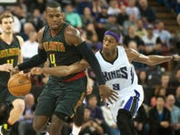 Sacramento Kings guard Rajon Rondo (9) attempts to steal the ball from Atlanta Hawks forward Paul Millsap (4) during the fourth quarter at Sleep Train Arena. The Sacramento Kings defeated the Atlanta Hawks 91-88.