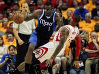 Apr 28, 2015; Houston, TX, USA; Dallas Mavericks center Amar'e Stoudemire (1) drives the ball as Houston Rockets forward Josh Smith (5) falls backwards during the second quarter in game five of the first round of the NBA Playoffs at Toyota Center.