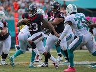 Arian Foster #23 of the Houston Texans rushes during a game against the Miami Dolphins at Sun Life Stadium on October 25, 2015 in Miami Gardens, Florida.