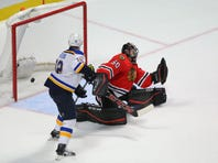 Nov 4, 2015; Chicago, IL, USA; St. Louis Blues right wing Vladimir Tarasenko (not pictured) scores a goal past Chicago Blackhawks goalie Corey Crawford (50) during the overtime period at the United Center. St. Louis won 6-5 in OT. Mandatory Credit: Dennis Wierzbicki-USA TODAY Sports