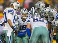 Dallas Cowboys quarterback Matt Cassel (16) calls a play in the huddle during the third quarter against the Green Bay Packers