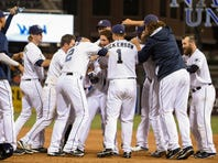 SAN DIEGO, CA - SEPTEMBER 8:  Austin Hedges #18 of the San Diego Padres, center, is congratulated by teammates after he hit a walk-off single during the ninth  inning of a baseball game against the Colorado Rockies at Petco Park September 8, 2015 in San Diego, California. The Padres won 2-1.  (Photo by Denis Poroy/Getty Images)  *** Local Caption *** Austin Hedges