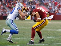 Washington Redskins tight end Jordan Reed (86) has his helmet ripped of by Dallas Cowboys strong safety Jeff Heath (38)