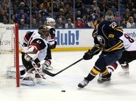 Dec 4, 2015; Buffalo, NY, USA; Arizona Coyotes goalie Mike Smith (41) stretches to make a save on Buffalo Sabres center Sam Reinhart (23) during the second period at First Niagara Center.