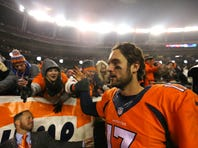 DENVER, CO - NOVEMBER 29: Quarterback Brock Osweiler #17 of the Denver Broncos walks off of the field after defeating the New England Patriots 30-24 in overtime at Sports Authority Field at Mile High on November 29, 2015 in Denver, Colorado. (Photo by Justin Edmonds/Getty Images)