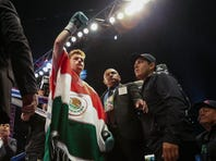 May 9, 2015; Houston, TX, USA;  Canelo Alvarez waves to the crowd before a super welterweight bout against James Kirkland (not pictured) at Minute Maid Park. Alvarez defeated Kirkland with a knockout in the third round.