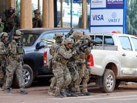French special forces take position in the surroundings of the Splendid hotel following an attack by Al-Qaeda linked gunmen on January 16, 2016 in Ouagadougou. 