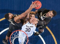Notre Dame Fighting Irish forward Zach Auguste (30) shoots the ball as Wake Forest Demon Deacons center Doral Moore (4) and forward Devin Thomas (2) defend in the second half at the Purcell Pavilion. The Fighting Irish won 85-62.
