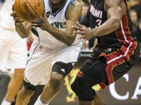 Nov 5, 2015; Minneapolis, MN, USA; Minnesota Timberwolves guard Andrew Wiggins (22) drives to the basket past Miami Heat guard Dwyane Wade (3) in the second half at Target Center. The Heat won 96-84.