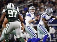 Dec 19, 2015; Arlington, TX, USA; Dallas Cowboys quarterback Kellen Moore (17) throws during the first half against the New York Jets at AT&T Stadium.