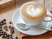 Cup of cafe latte and coffee beans