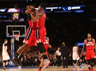 Feb 9, 2016; New York, NY, USA; Washington Wizards guard John Wall (2) and guard Bradley Beal (3) chest bump in celebration during the fourth quarter against the New York Knicks at Madison Square Garden. Washington Wizards won111-108. Mandatory Credit: Anthony Gruppuso-USA TODAY Sports