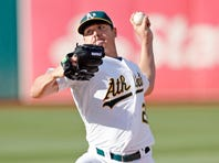 Jul 18, 2015; Oakland, CA, USA; Oakland Athletics starting pitcher Scott Kazmir (26) pitches during the first inning against the Minnesota Twins at O.co Coliseum.