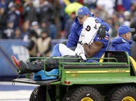Marcus Easley is carted off the field during Sunday's game with Dallas.