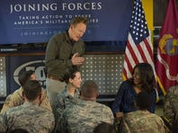 Conan O'Brien entertains troops at Al Udeid Air Base in Qatar with first lady Michelle Obama Tuesday.