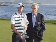 Vaughn Taylor (left) and Clint Eastwood (right) pose for a photo after Taylor won the AT&T Pebble Beach National Pro-Am at Pebble Beach Golf Links.