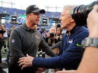 Dec 13, 2015; Baltimore, MD, USA; Baltimore Ravens head coach John Harbaugh (left) shakes hand with Seattle Seahawks head coach Pete Carroll (right) after the game at M&T Bank Stadium. The Seahawks won 35-6. Mandatory Credit: Evan Habeeb-USA TODAY Sports