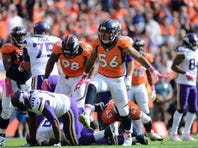 Denver Broncos linebacker Shane Ray (56) celebrates his sack in the first quarter against the Minnesota Vikings at Sports Authority Field at Mile High.