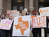 Abortion rights activists rally in February against Texas' abortion law on the steps of the Capitol in Austin.