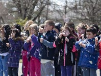 Kingston Elementary School students blow bubbles during World Autism Awareness Day on April 2, 2013 in Cherry HIll, N.J.