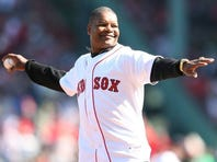 BOSTON - OCTOBER 11: Former MLB player Dave Henderson throws out the ceremonial first pitch before Game Three of the ALDS between the Boston Red Sox and the Los Angeles Angels of Anaheim during the 2009 MLB Playoffs at Fenway Park on October 11, 2009 in Boston, Massachusetts.