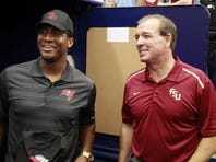 Florida State head coach Jimbo Fisher (R) talks to Tampa Bay Buccaneers and former Florida State player quarterback Jameis Winston (R) prior to the game between the Tampa Bay Rays and Baltimore Orioles at Tropicana Field on July 26, 2015.