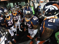 Jan 17, 2016; Denver, CO, USA; Denver Broncos strong safety T.J. Ward (43) rallies his teammates before the AFC Divisional round playoff game at Sports Authority Field at Mile High. Mandatory Credit: Ron Chenoy-USA TODAY Sports