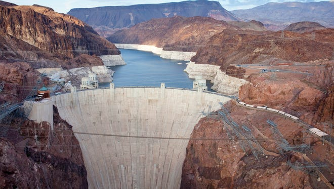 The Hoover Dam, originally known as Boulder Dam, was dedicated by President Franklin D. Roosevelt in 1935. Nearly a million people tour the dam each year.