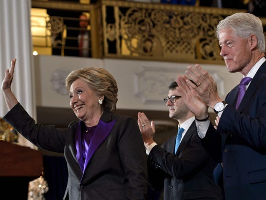 Hillary Clinton waves to staff and supporters after