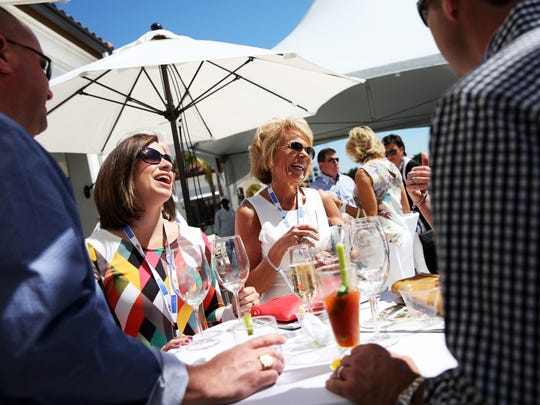 Melissa Hunt, left, and Cindy Brown, both of Fort Myers, laugh together during the Southwest Florida Wine and Food Fest on Feb. 27, 2016. Southwest Florida Children's Charities Inc. will uncork the power of giving again this year at the annual Wine & Food Fest on Feb. 24-25 at Miromar Lakes Beach and Golf Club.