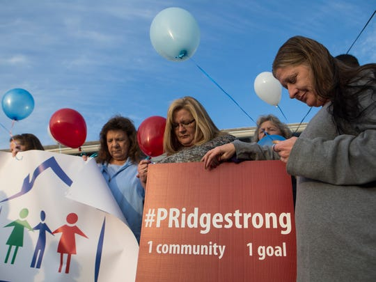 Pleasant Ridge residents stand hand-in-hand in prayer