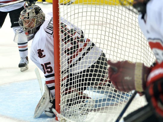 St. Cloud State goaltender Charlie Lindgren (35) peeks behind the net during a Pioneers possession in the first period of the NCHC Frozen Faceoff game Friday at Target Center in Minneapolis.